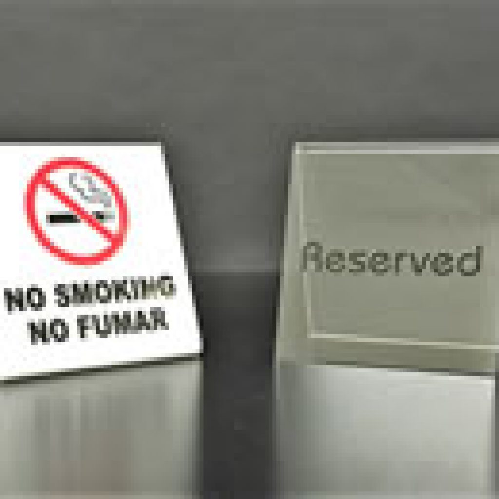Plastic No Smoking and Reserved Sign