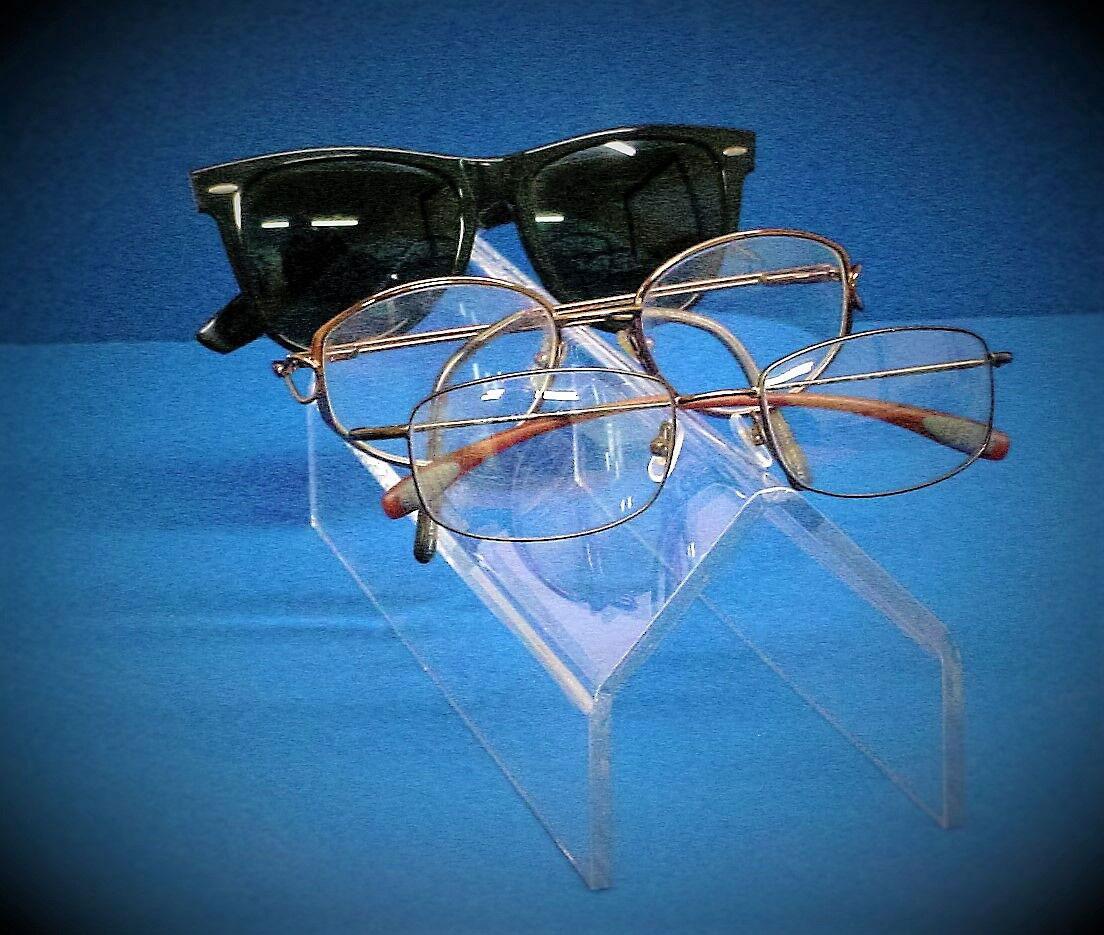 eyewear display with blue background